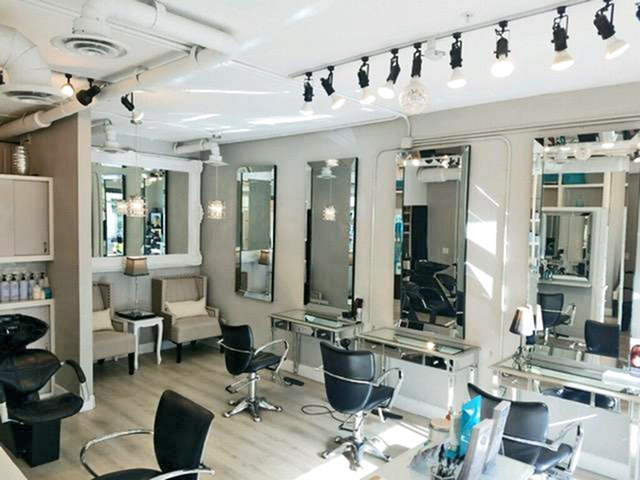 Enjoy Our Volume Hair Studio, With View of Chairs, Mirrors, Sitting Area, Hair Product at The Marq Highland Park Apartments