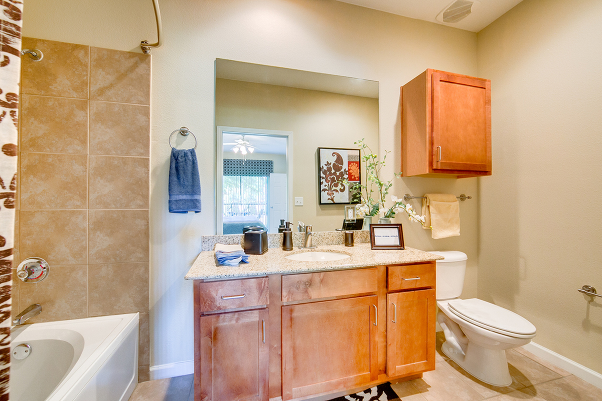 View of Bathroom, Showing Single Vanity, Storage, Tile Flooring and Oversized Tub at Enclave on Golden Triangle Apartments