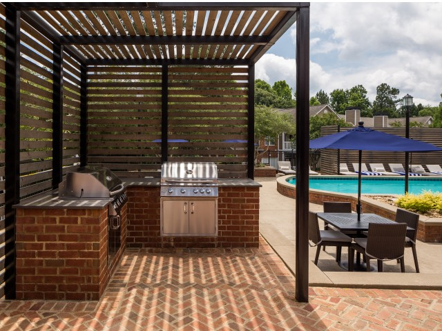 View of Grilling Lounge, Showing Grills, Pergola, and Picnic Area at Retreat at Peachtree City Apartments