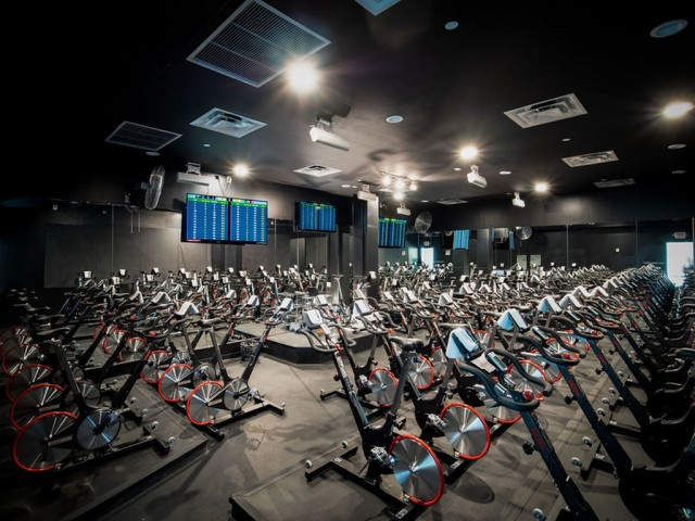 Enjoy Our Vibe Spin Studio, With View of Workout Studio with Stationary Bikes and TVs at 935M Apartments