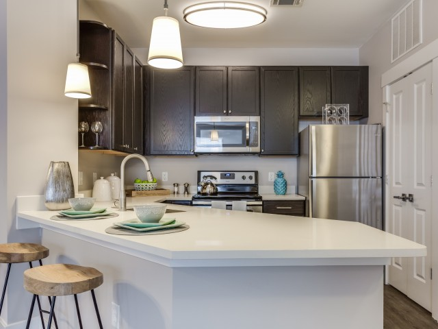 Apartment Amenity | Breakfast Bar | Granite Style Counters | Cottonwood Reserve Apartments