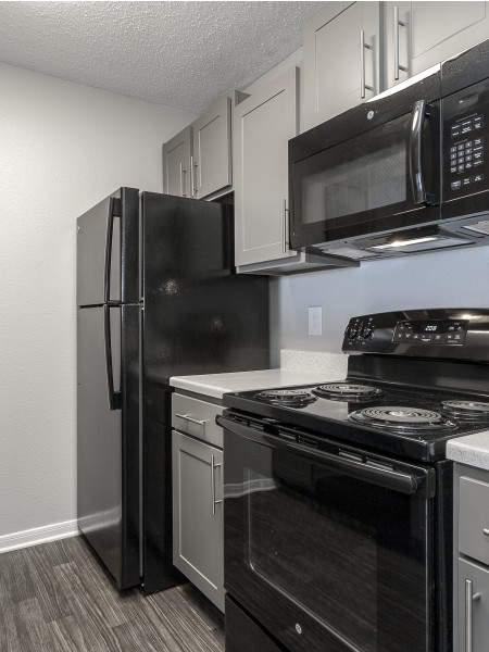 View of the Renovated Apartment Interior at 1070 Main Apartments, Showing Kitchen with Gas Appliances and Modern Hardware
