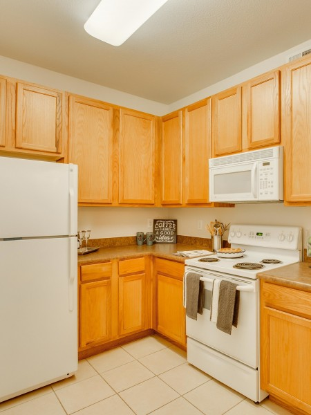 View of the Kitchen at Cottonwood Ridgeview Apartments, Showing Appliances and Cabinets