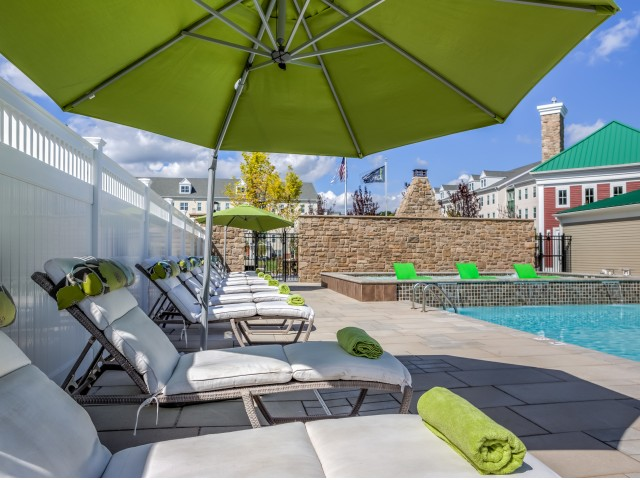 Enjoy Our Resort Inspired Pool, With Loungers, Umbrellas, and Sun deck at Cottonwood One Upland Apartments