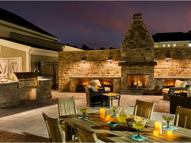 Enjoy Our Outdoor Lounge, With View of Seating, Gas Grills, and Brick Fireplace at Cottonwood One Upland Apartments
