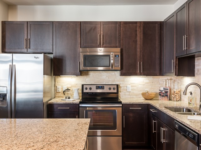 Image of kitchen showing counters and stainless steel appliances