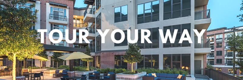 Tour Your Way - View of Outdoor Lounge, Showing Seating Areas, Apartments in Background, and Outdoor Furniture at 3800 Main Apartments