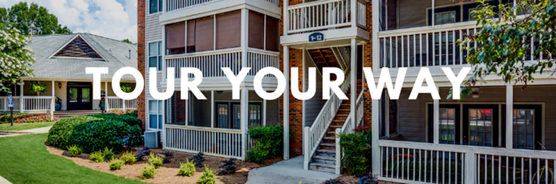 Tour Your Way - View of Building Exterior, Showing Landscaping, Walkway, and Private Patios and Balconies at Plantations at Haywood Apartments