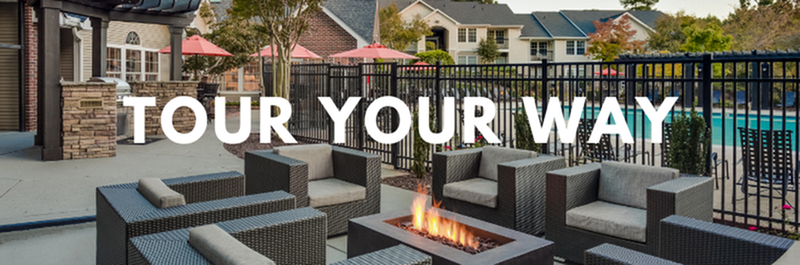 Tour Your Way - View of Outdoor Lounge, Showing Fenced-in Pool Area, Grilling Area, and Fire Pit at Midtown Crossing Apartments