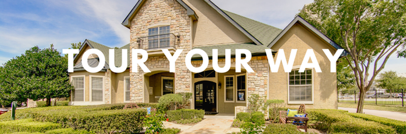 Tour Your Way - View of Clubhouse, Showing Landscaping, Bench, and Entrance at Stonebriar of Frisco Apartments