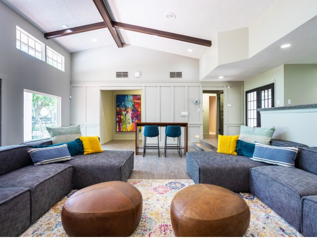 View of Clubhouse, Showing Newly Renovated Interior, Seating Area, Décor, Windows, and hallways at Solara Apartments