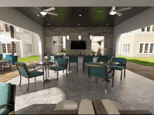 View of Grilling Lounge Bar Area, Showing Bar with Stools, Seating Area, and Adjacent Shaded Seating at Murano at Three Oaks Apartments