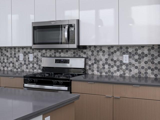 Quartz Countertops with Hex Mosaic Backsplash
