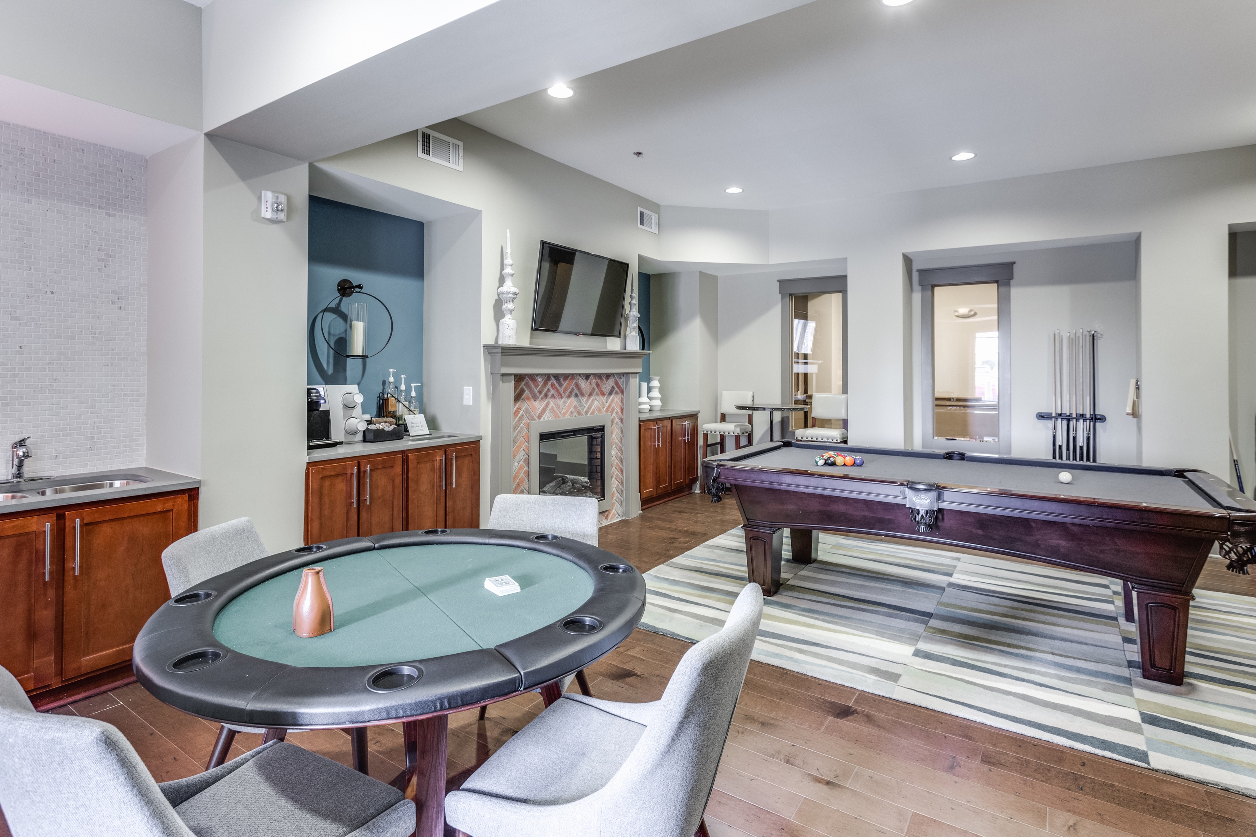 View of Game Room, Showing Poker Table, Chairs, Pool Table, and Café Bar at Alpha Mill Apartments