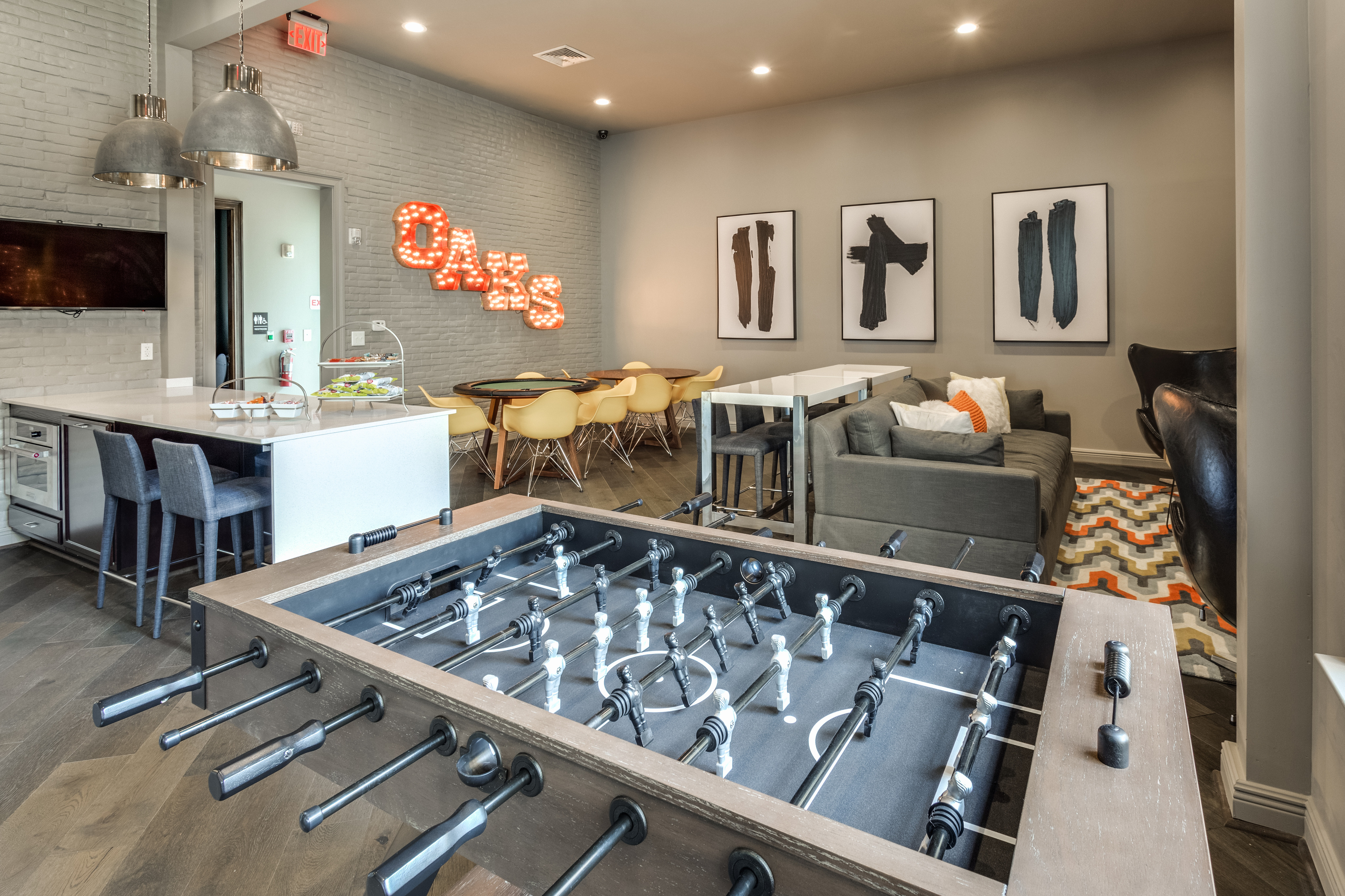 View of Clubroom, Showing Foosball Table, Seating Area, and Card Tables at Cottonwood Reserve Apartments