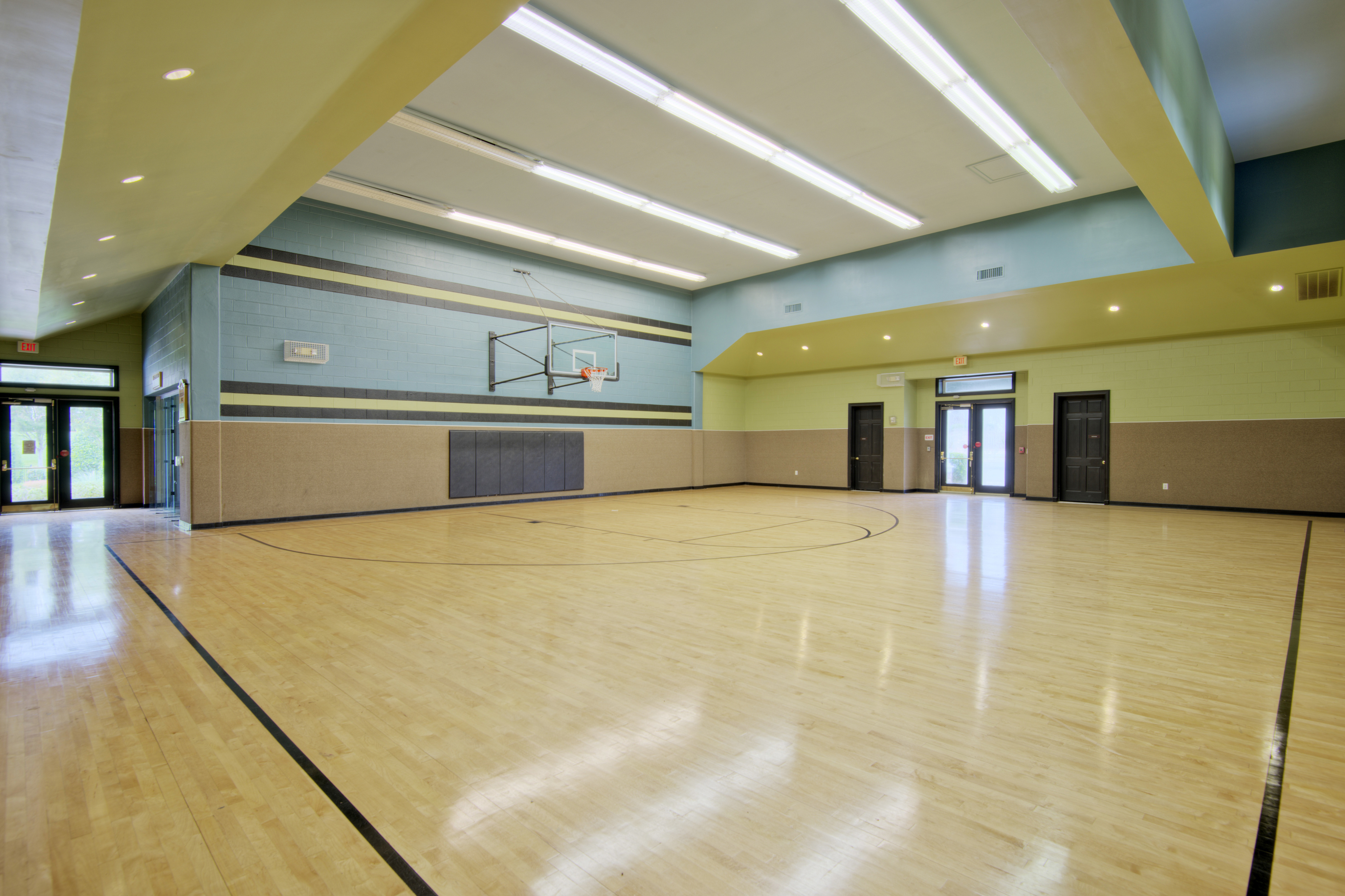 View of Indoor Sport Court, Showing Full-Size Basketball Court at Cottonwood Reserve Apartments