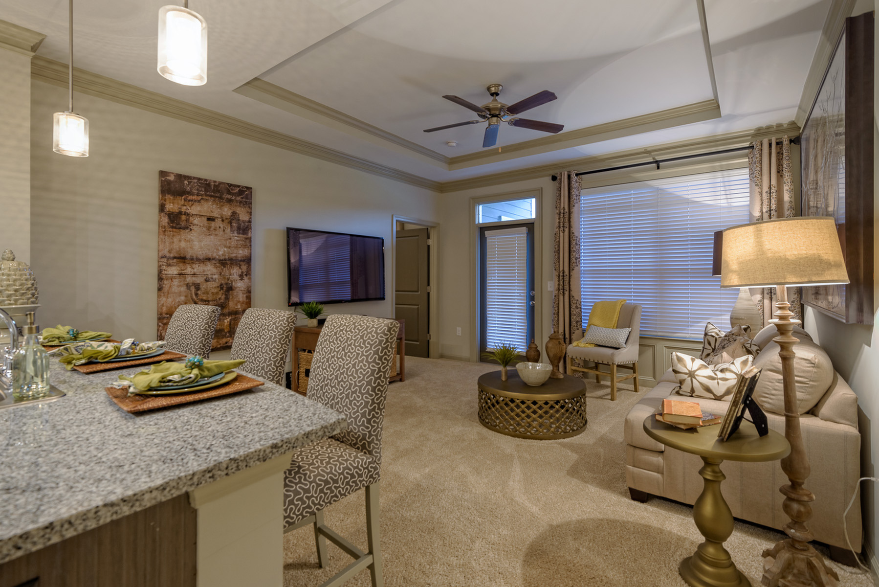View of Living Room, Showing Bar Stools, Ceiling Fan, and Window View at Heights at Meridian Apartments