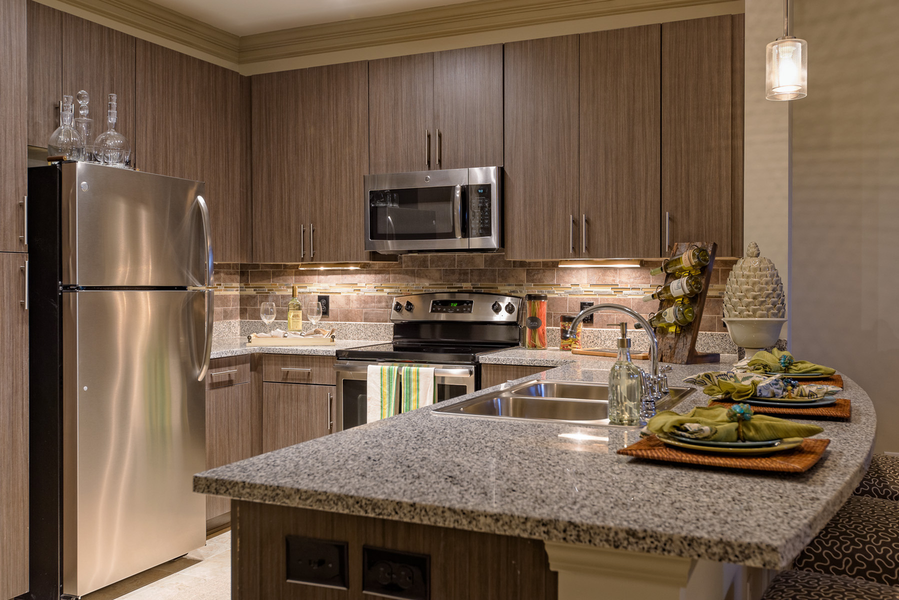 View of Kitchen, Showing Granite Countertop and Stainless Steel Appliances at Heights at Meridian Apartments