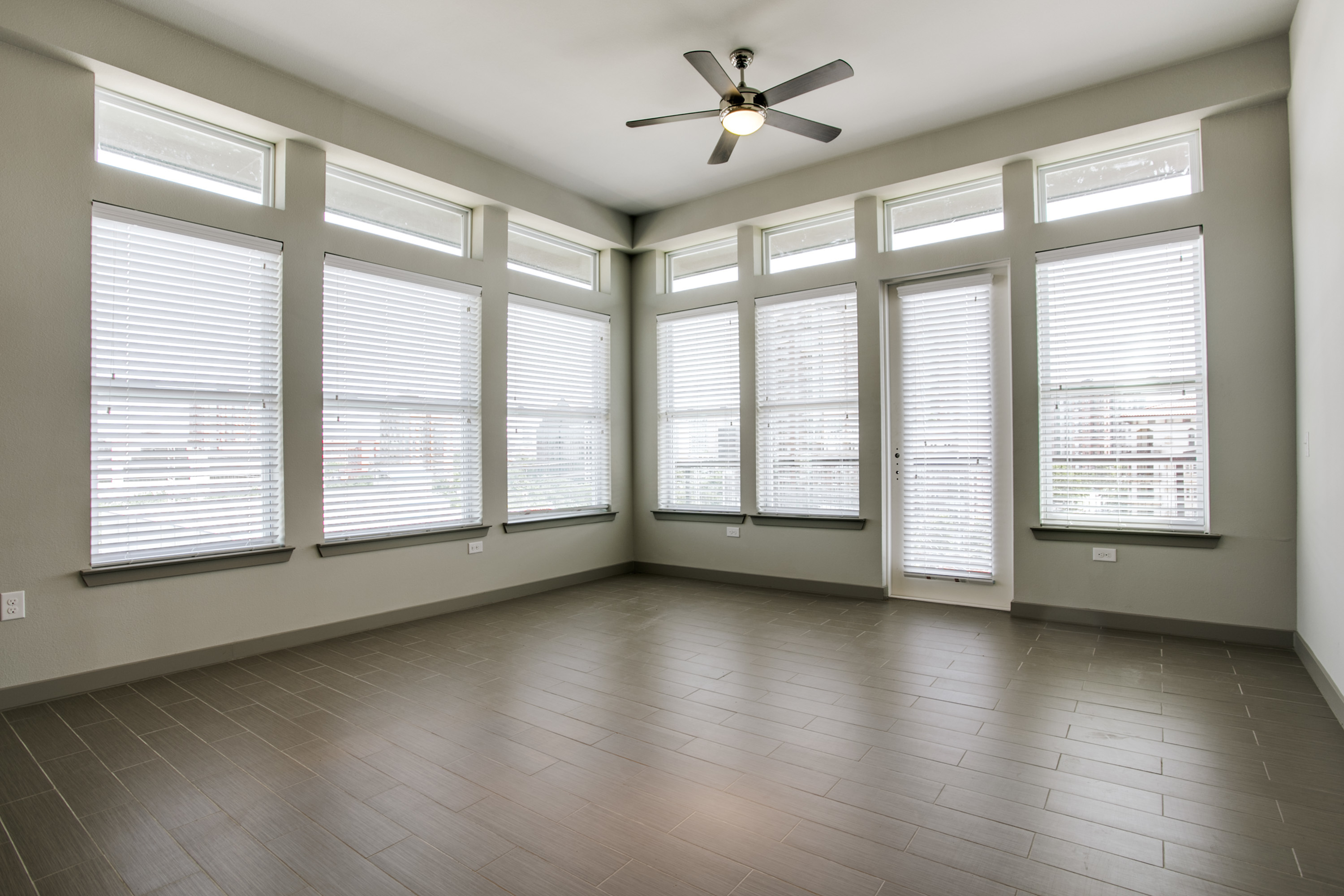 View of Living Room, Showing Ceiling Fan and Window Views at Routh Street Flats Apartments