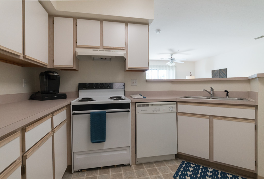 View of Kitchen, Showing Gas Appliances, Counters, Cabinetry, Double Sink, and Tile Flooring at Clearview Apartments
