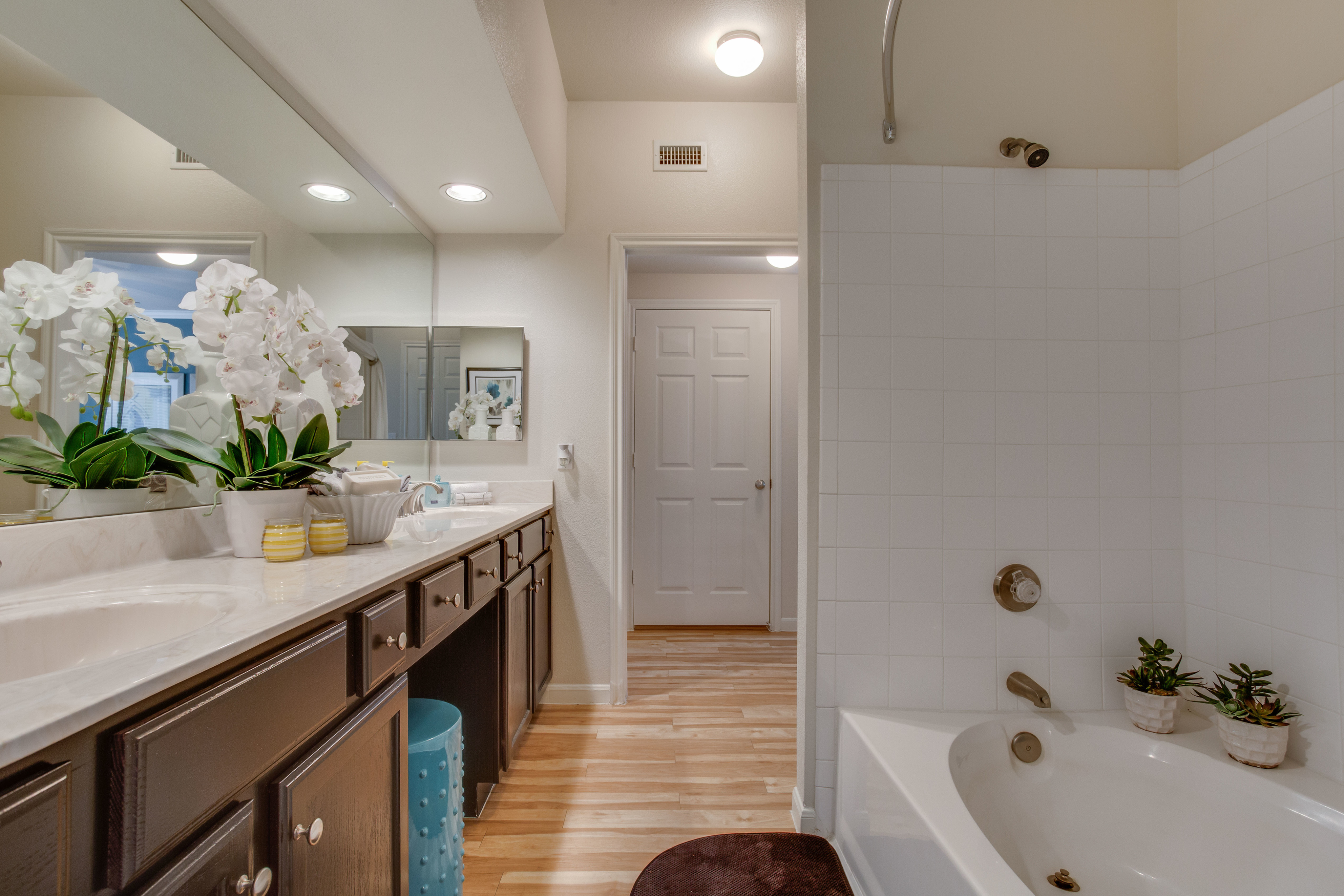 View of  Bathroom with Garden Tub, Double Sink, and Plank-Wood Flooring with Raveneaux Apartments
