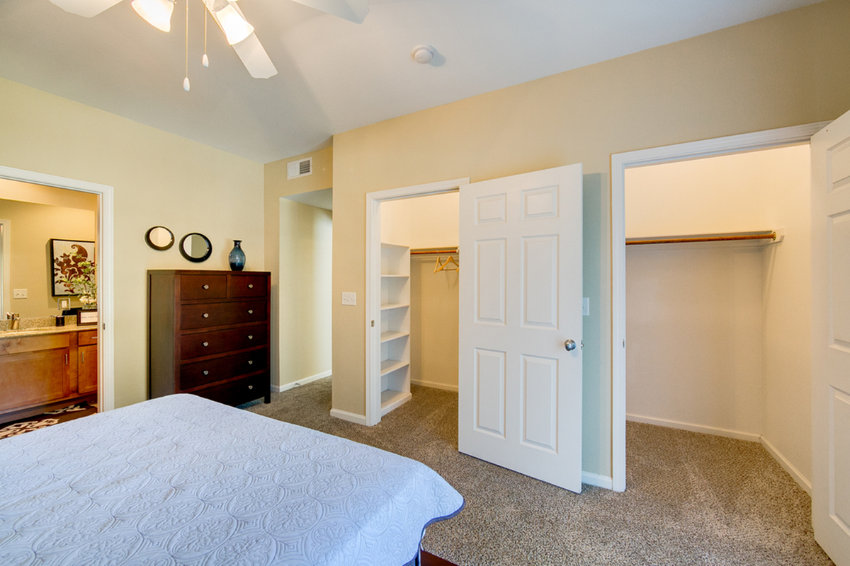 View of Furnished Bedroom, Showing Carpet, Walk-In Closet, and Attached Bathroom at Enclave on Golden Triangle Apartments