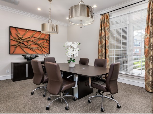 View of Business Center, Showing Meeting Table, Chairs, and Window Views at Retreat at Peachtree City Apartments