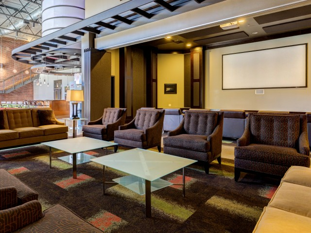 View of Movie Screening Lounge, Showing Seating Area and Projector Screen at The Melrose Apartments