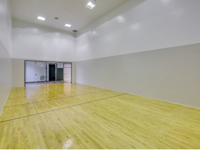 View of Racquetball Court, Showing 2 Tone Walls and Wood Floor at Cottonwood Ridgeview Apartments