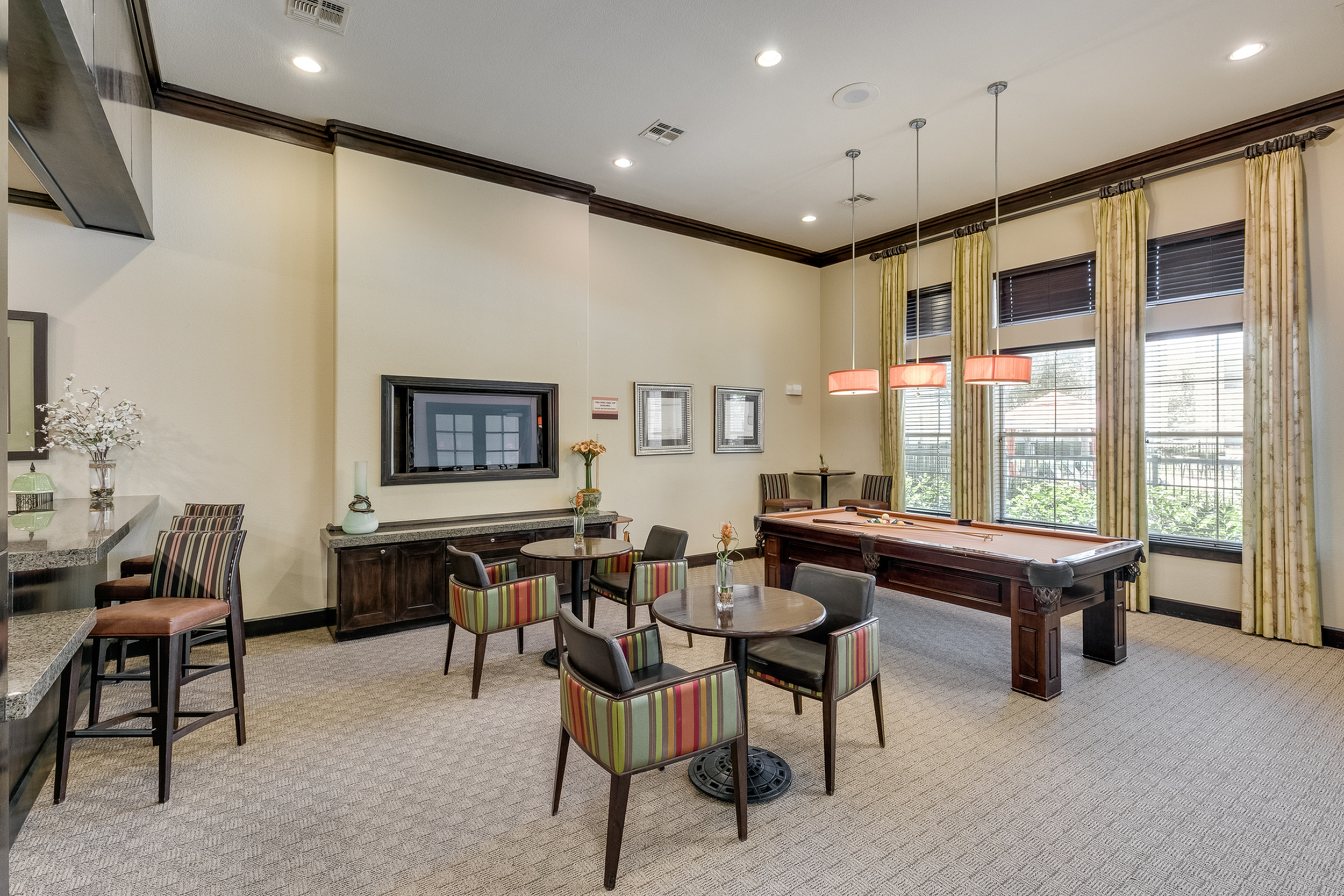 View of Clubroom, Showing Pool Table, Seating, Décor, and Windows at Retreat at Stafford Apartments