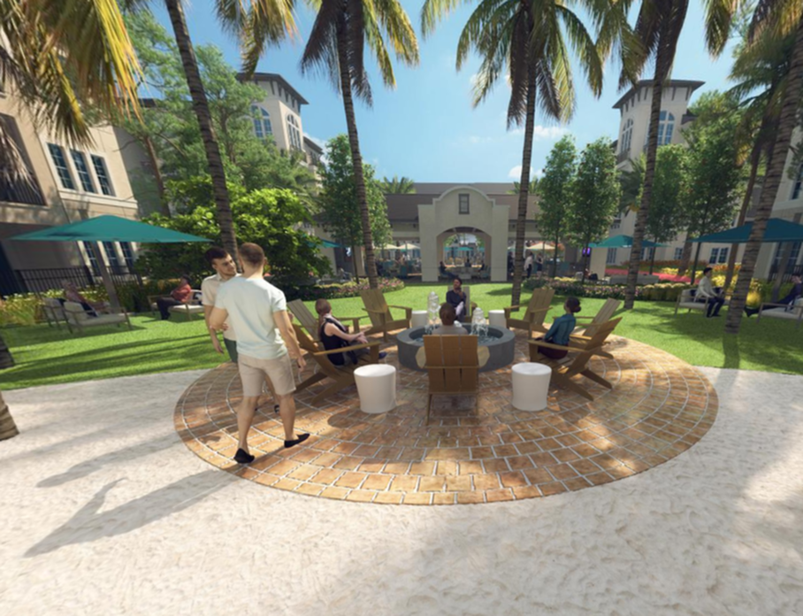View of Seating Near Water Feature, Showing Water Feature Circled with Seating Near Grass in Courtyard at Murano at Three Oaks Apartments