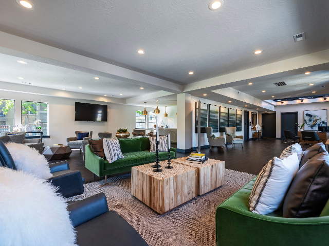 View of Clubhouse at Cottonwood Apartments with couch and other seating areas.