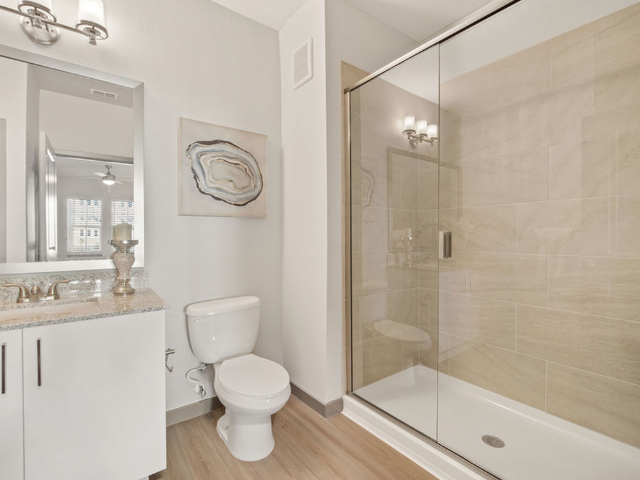 Enjoy Our Stand-Up Shower, With View of Bathroom Vanity, Toliet, and Stand-Up Shower at Murano at Three Oaks Apartments