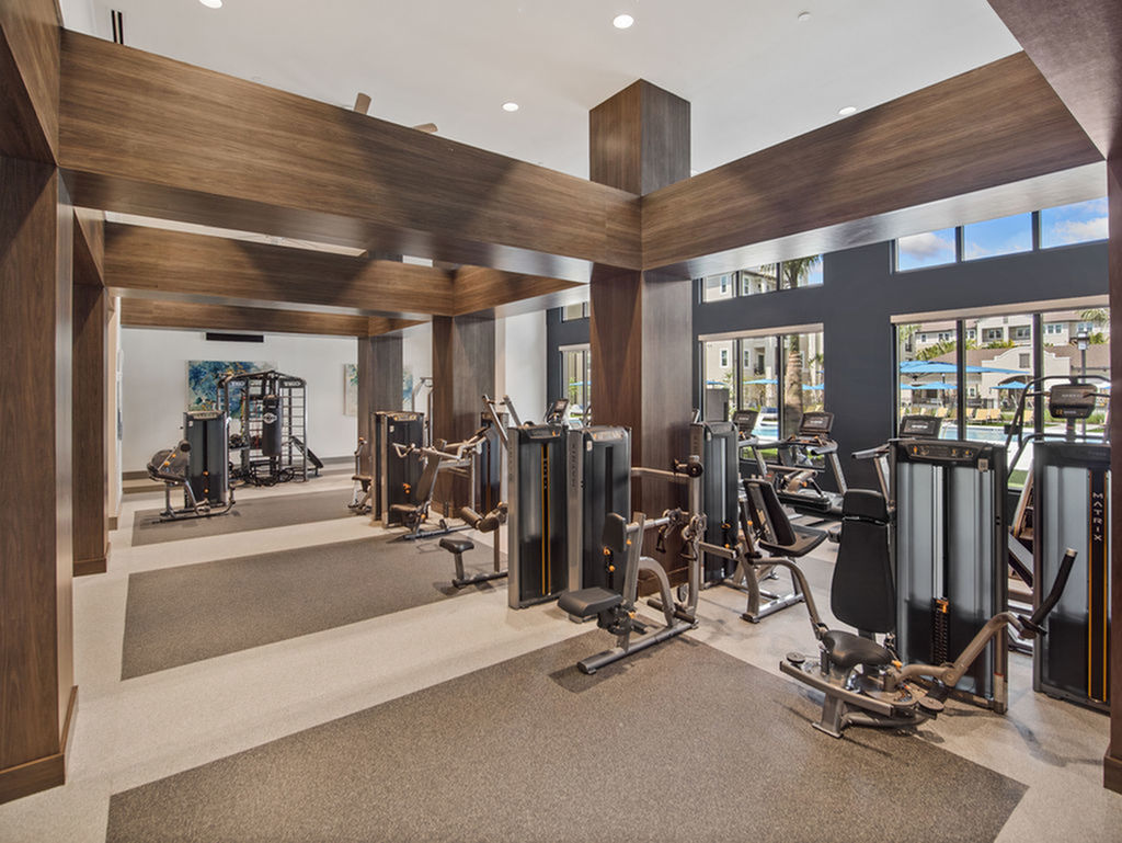 Enjoy Our Fitness Center , With View of Showing cardio and weight machines at Murano at Three Oaks Apartments