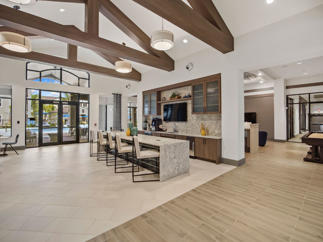 Enjoy Our Demo Kitchen , With View of Demo Kitchen with Bar in WiFi Lounge Area at Murano at Three Oaks Apartments