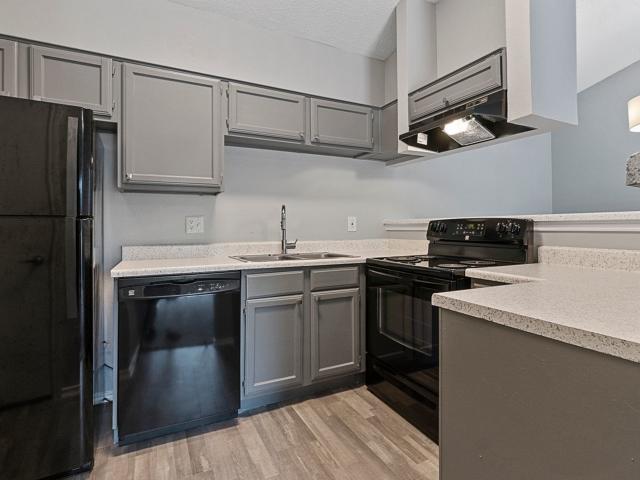 View of ktchen with black appliances at 4804 Haverwood Apartments