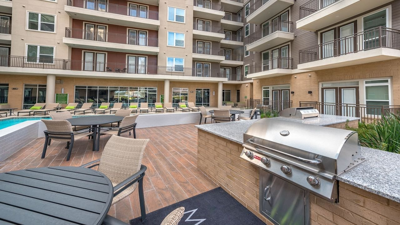 Dining Deck with Outdoor Grills and Seaating | Modera Flats