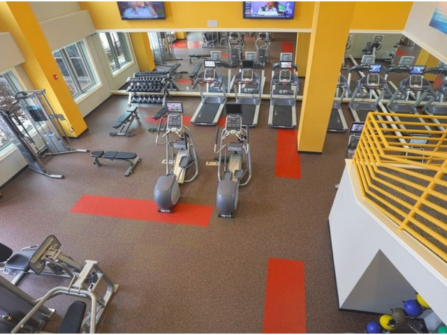 Image of Fitness studio with towel service and cardio equipment with individual TV's for Modera 44