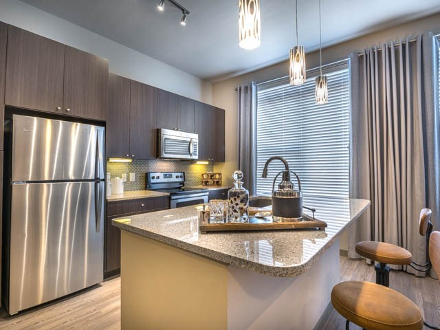 Chefs Island with Breakfast Bar and Custom Cabinets in Kitchen | Modera Flats
