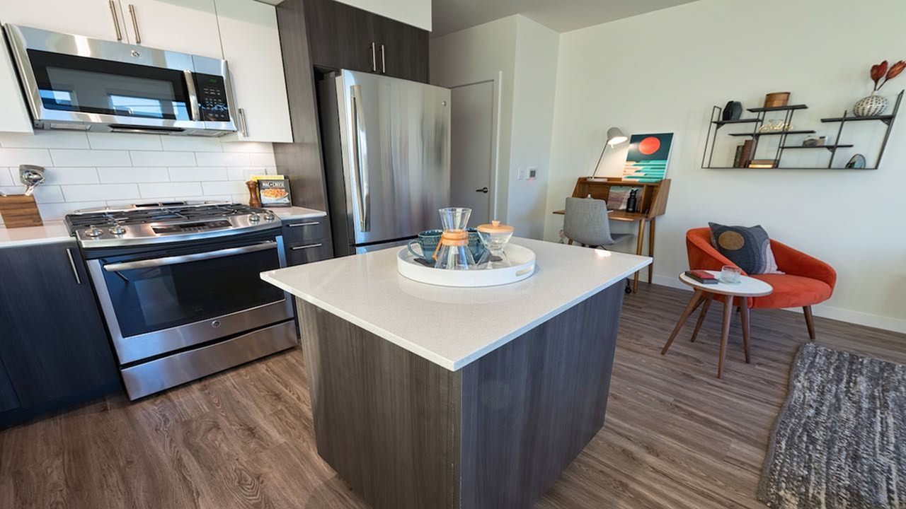 Image of Wood plank-style flooring in living areas and baths for Modera South Lake Union
