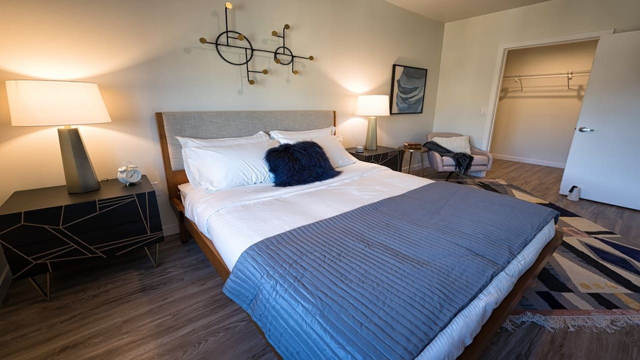 Bedroom with king sized bed and nightstand