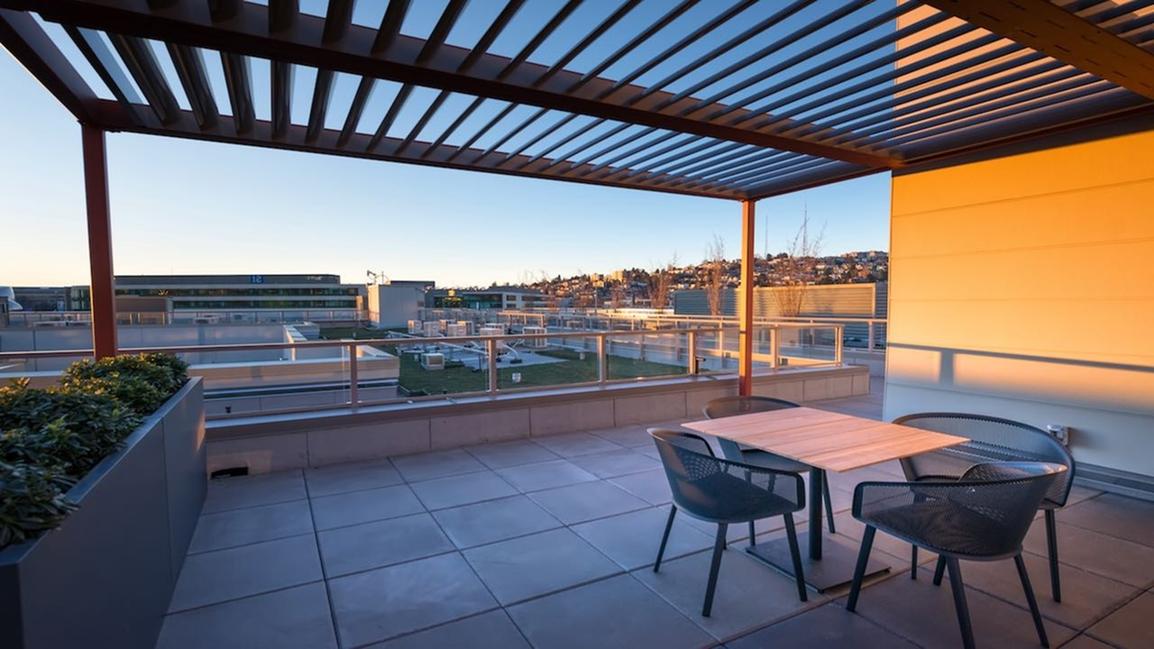 Image of Rooftop deck with stunning city and lake views for Modera South Lake Union
