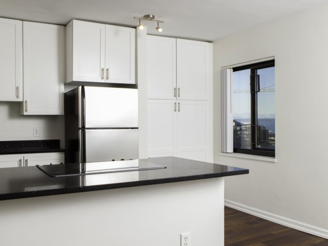 Image of Well-equipped kitchen with ample cabinetry for Skye at Belltown