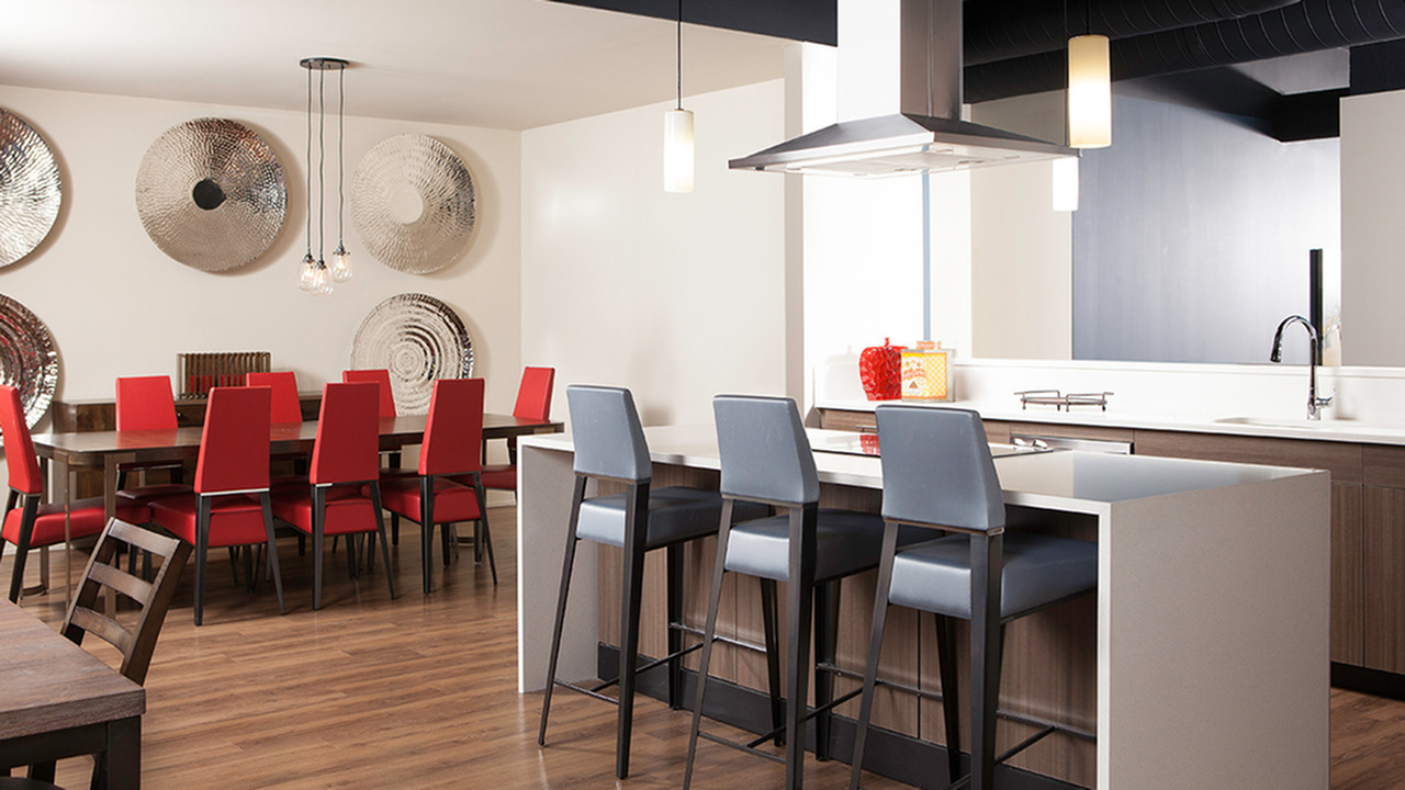 Kitchen in clubroom with ample seating options