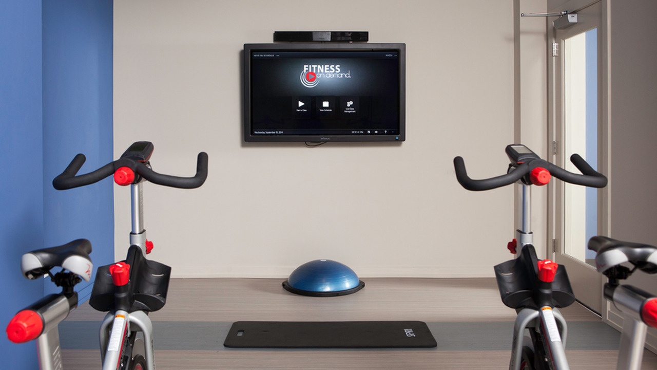 Image of Fully equipped fitness center with cardio theatre equipment for Skye at Belltown