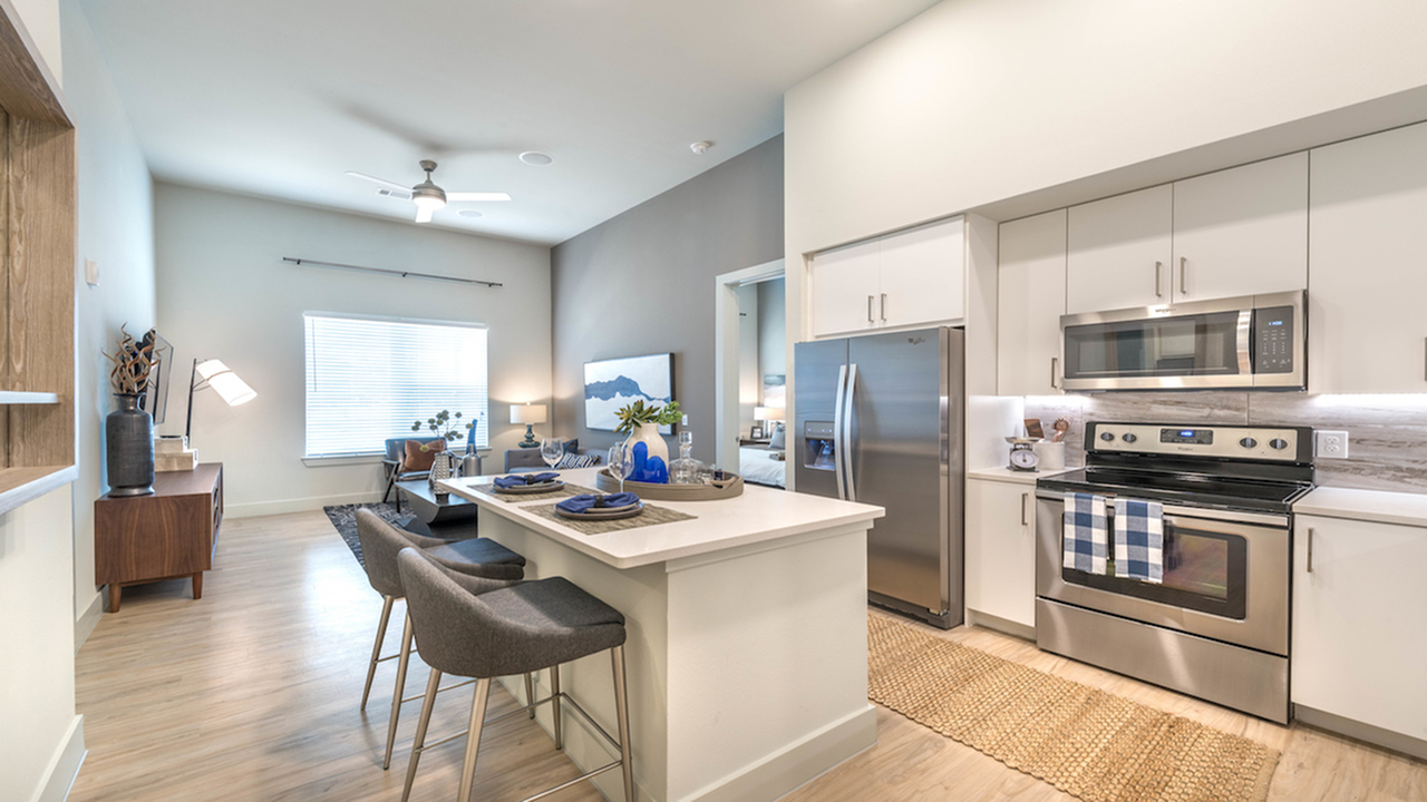 Generous, Open Concept Kitchen with White Cabinetry, Tile Back Splash and Stainless Steel Appliances