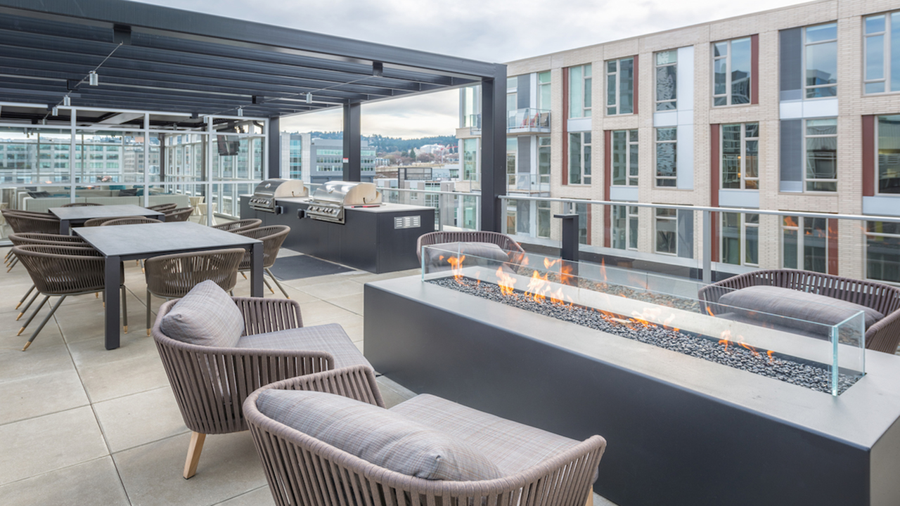 Roof top sundeck with social seating around a fire pit