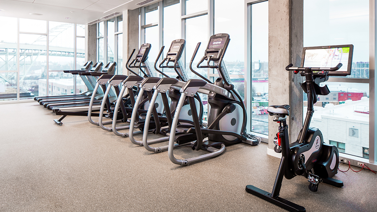 Spacious fitness studio with cardio equipment