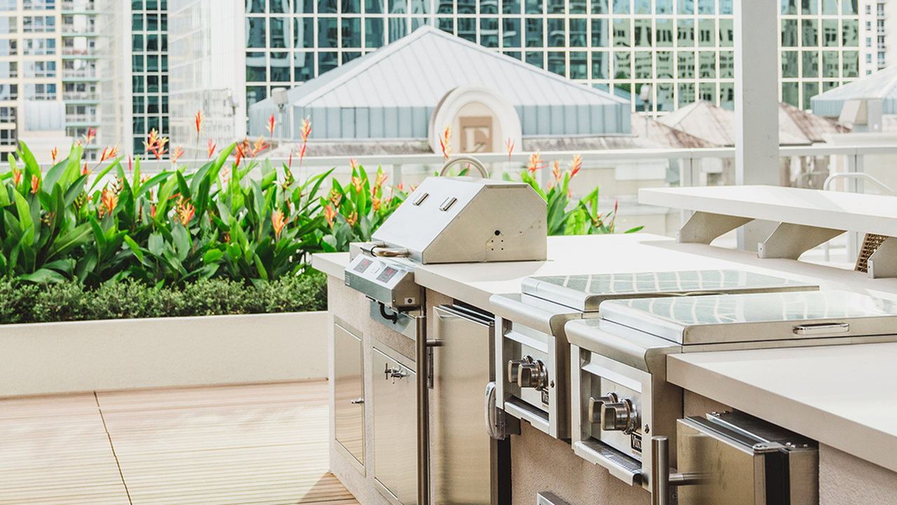 Exterior grilling stations near pool