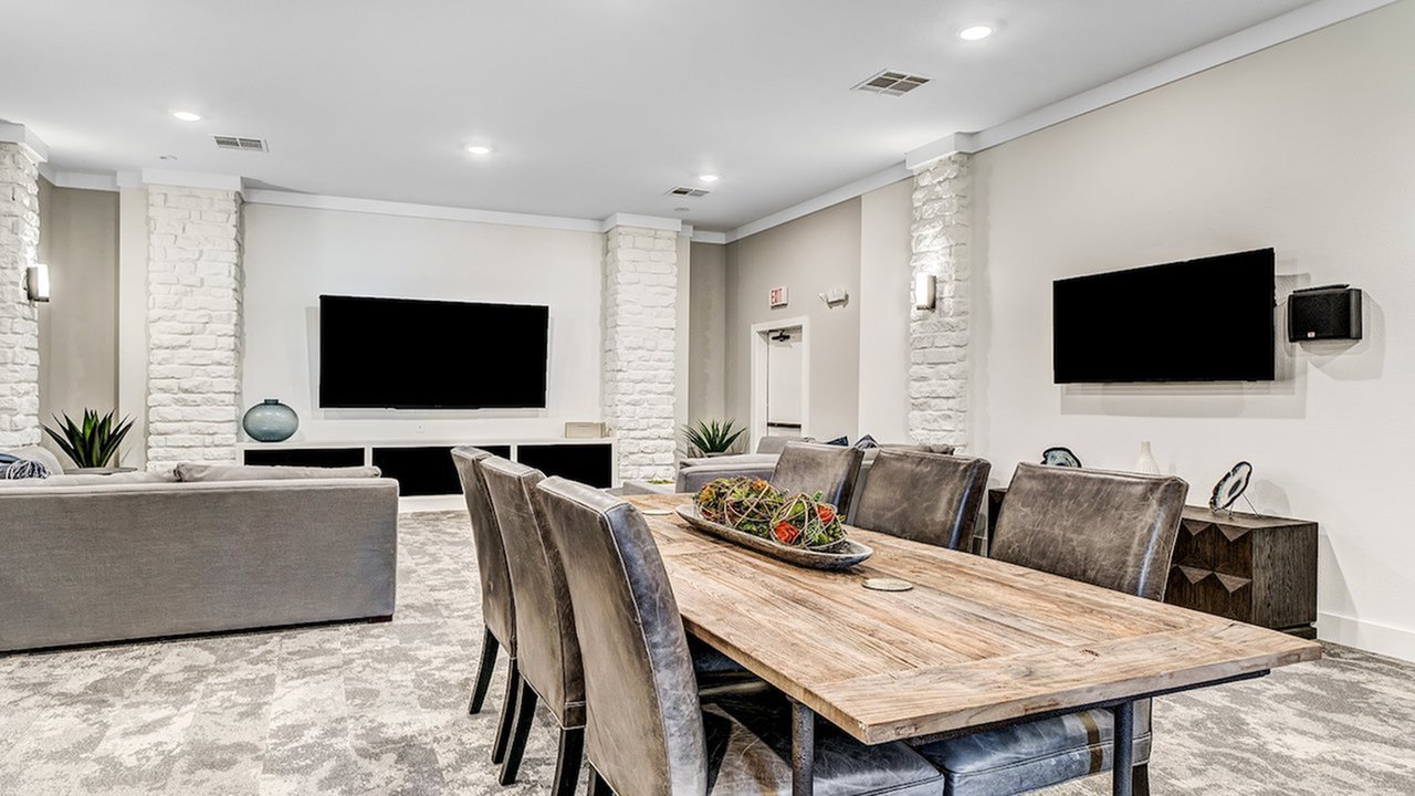 Media Lounge with plush seating and TVs | Alister Balcones | Austin, Texas | Apartment Homes | Cozy Living Spaces